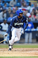 Asheville Tourists right fielder Ramon Marcelino (12) swings at a pitch during a game against the Columbia Fireflies at McCormick Field on April 12, 2018 in Asheville, North Carolina. The Fireflies defeated the Tourists 7-5. (Tony Farlow/Four Seam Images)