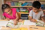 Education Elementary School Kindergarten mathematics using manipulatives, boy and girl working side by side