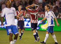 Chivas USA forward Alecko Eskandarian (7) reacts to narrowly missing a goal in his return from injury during a MLS match. The San Jose Earthquakes and Chivas USA played to 0-0 draw at Home Depot Center stadium on Saturday, August 23, 2008.