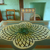 A table has been painted with a symmetrical geometric  pattern