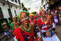 Afro-Colombian dancers of the Alameda Reyes neighborhood take part in the San Pacho festival in Quibdó, Colombia, 2 October 2019. Every year at the turn of September and October, the capital of the Pacific region of Chocó holds the celebrations in honor of Saint Francis of Assisi (locally named as San Pacho), recognized as Intangible Cultural Heritage by UNESCO. Each day carnival groups, wearing bright colorful costumes and representing each neighborhood, dance throughout the city, supported by brass bands playing live music. The festival culminates in a traditional boat ride on the Atrato River, followed by massive religious processions, which accent the pillars of Afro-Colombian's identity – the Catholic devotion grown from African roots.