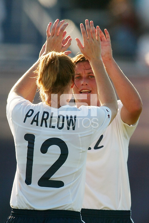 Abby Wambach celebrates Cindy Parlow's goal in the 31st minute. The USWNT defeated Russia 5-1 on  September 29, at Mitchel Athletic Complex, Uniondale, NY.