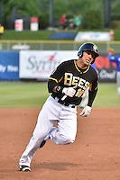 Efren Navarro (16) of the Salt Lake Bees hustles towards third base against the Las Vegas 51s at Smith's Ballpark on May 8, 2014 in Salt Lake City, Utah.  (Stephen Smith/Four Seam Images)