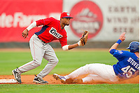 Pat Stover (45) of the Ogden Raptors slides into second base as Orem Owlz shortstop Sherman Johnson (4) fields the throw at Lindquist Field on July 29, 2012 in Ogden, Utah.  The Owlz defeated the Raptors 6-4.   (Brian Westerholt/Four Seam Images)
