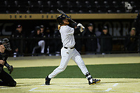William Simoneit (8) of the Wake Forest Demon Deacons follows through on his swing against the Louisville Cardinals at David F. Couch Ballpark on March 6, 2020 in  Winston-Salem, North Carolina. The Cardinals defeated the Demon Deacons 4-1. (Brian Westerholt/Four Seam Images)