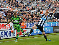 Jack Colback of Newcastle United blocks a shot from Angel Rangel of Swansea City during the Barclays Premier League match between Newcastle United and Swansea City played at St. James' Park, Newcastle upon Tyne, on the 16th April 2016