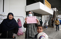 """Pictured: A woman protester with a """"We Are Human"""" placard Monday 06 February 2017<br /> Re: Scuffles between migrants and police broke out during a visit by Immigration Policy Minister Yiannis Mouzalas at the Elliniko migrant camp located in the former airport in the outskirts of Athens, Greece."""