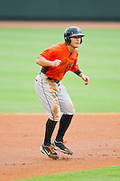 Johnny Ruettiger (14) of the Frederick Keys takes his lead off of second base against the Winston-Salem Dash at BB&T Ballpark on July 21, 2013 in Winston-Salem, North Carolina.  The Dash defeated the Keys 3-2.  (Brian Westerholt/Four Seam Images)