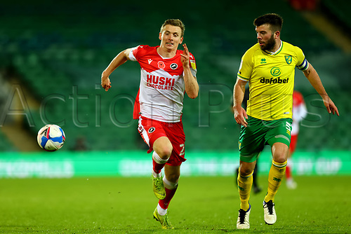 3rd November 2020; Carrow Road, Norwich, Norfolk, England, English Football League Championship Football, Norwich versus Millwall; Jon Daoi Boovarsson of Millwall competes for the ball with Grant Hanley of Norwich City