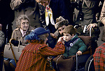 Princess Diana, talking to boy in wheelchair.<br /> Their first tour of Wales together in after their marriage 1982. 1980s. UK