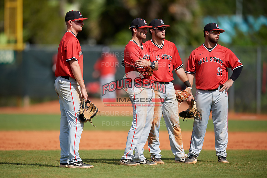 Ball State Cardinals infielders William Baker (32), Noah Powell (9), Noah Navarro (8), and John Ricotta (31) during a game against the Mount St. Mary's Mountaineers on March 9, 2019 at North Charlotte Regional Park in Port Charlotte, Florida.  Ball State defeated Mount St. Mary's 12-9.  (Mike Janes/Four Seam Images)