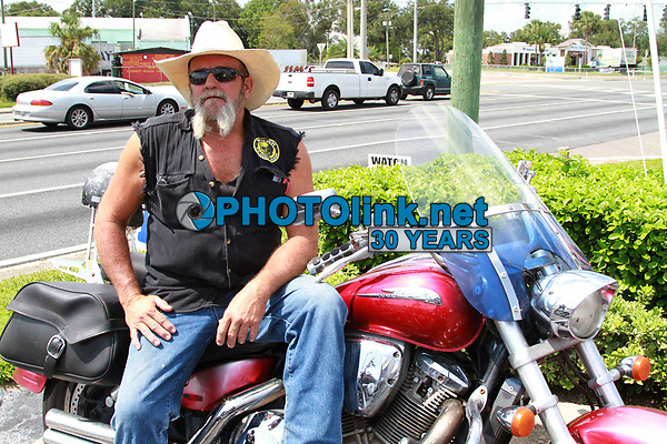 Docs3868.JPG<br /> 3/30/2013<br /> Dade CIty, FL 9/23/12<br /> Doc's Grille Motorcycle Fest<br /> Photo by Adam Scull/PHOTOlink.net<br /> 917-754-8588 - eMail: adam@photolink.net