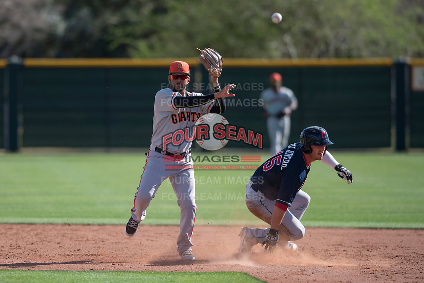 San Francisco Giants second baseman Kevin Rivera (15) attempts to turn a double play around Clark Scolamiero (15) during a Minor League Spring Training game against the Cleveland Indians at the San Francisco Giants Training Complex on March 14, 2018 in Scottsdale, Arizona. (Zachary Lucy/Four Seam Images)