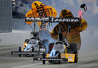 Nov. 12, 2011; Pomona, CA, USA; NHRA top fuel dragster driver Mike Ashley (right) races alongside Dom Lagana during qualifying at the Auto Club Finals at Auto Club Raceway at Pomona. Mandatory Credit: Mark J. Rebilas-.