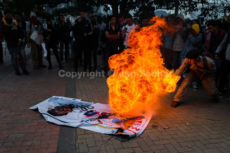 A student of the Universidad Nacional de Colombia spits fire during a protest march against government's policies and corruption within the public educational system in Bogotá, Colombia, 24 October 2019.