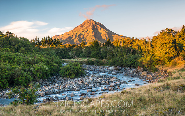 Sunrise over Waiwhakaiho River and Taranaki, Mt. Egmont, in background, Egmont National Park, North Island, New Zealand, NZ