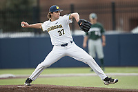Michigan Wolverines pitcher Karl Kauffmann (37) delivers a pitch to the plate against the Michigan State Spartans during the NCAA baseball game on April 18, 2017 at Ray Fisher Stadium in Ann Arbor, Michigan. Michigan defeated Michigan State 12-4. (Andrew Woolley/Four Seam Images)