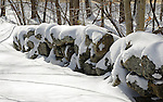 Snow Covered Stonewall in the Winter Woods of New Hampshire