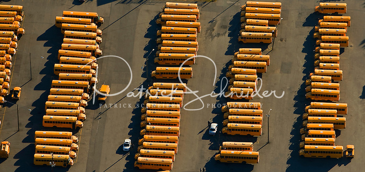 Aerial view of lines of buses waiting to pick up children for a day of school.