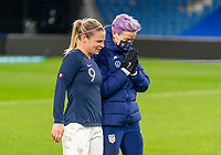 LE HAVRE, FRANCE - APRIL 13: Eugenie Le Sommer #9 of France talks with Megan Rapinoe #15 of the USWNT after a game between France and USWNT at Stade Oceane on April 13, 2021 in Le Havre, France.