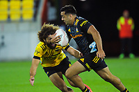 Chiefs' Chase Tiatia skins Orbyn Leger during the Super Rugby Aotearoa match between the Hurricanes and Chiefs at Sky Stadium in Wellington, New Zealand on Saturday, 20 March 2020. Photo: Dave Lintott / lintottphoto.co.nz