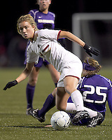 """Boston College forward Kristen Mewis (19) maintains control after University of Washington defender Molly Boyd (25) failed tackle. In overtime, Boston College defeated University of Washington, 1-0, in NCAA tournament """"Elite 8"""" match at Newton Soccer Field, Newton, MA, on November 27, 2010."""