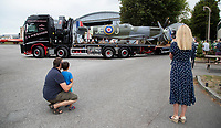 BNPS.co.uk (01202) 558833. <br /> Pic: CorinMesser/BNPS<br /> <br /> Pictured: The replica Spitfire arrives. <br /> <br /> A full-sized model Spitfire has been built as a memorial to the women and children who constructed over 2,000 of them in secret during World War Two.<br /> <br /> The crucial little-known operation involved just a few hundred people who operated in requisitioned car garages, sheds, workshops and factories in the city of Salisbury, Wilts.<br />  <br /> They had to sign of Official Secrets Act and worked with such discretion that the Wiltshire city's inhabitants were oblivious to it.<br /> <br /> They built the legendary aircraft in piecemeal, with the parts coming together to be assembled in one large factory that is now the local rugby club.
