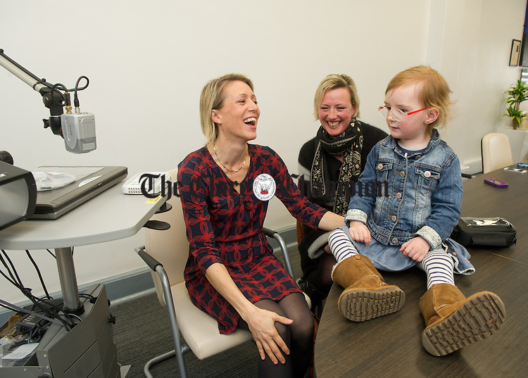 Three year old Brianna Lynch with her doctor Dr Liz O Mahoney, left,  as she sits with her mother  Arabella Scanlan at the handing over of a new ambulatory EEG machine to University Hospital Limerick. Photograph by John Kelly.