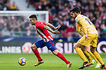 Angel Correa (L) of Atletico de Madrid runs past Alex Granell Nogue and Juan Pedro Ramirez Lopez, Juanpe, of Girona FC during the La Liga 2017-18 match between Atletico de Madrid and Girona FC at Wanda Metropolitano on 20 January 2018 in Madrid, Spain. Photo by Diego Gonzalez / Power Sport Images