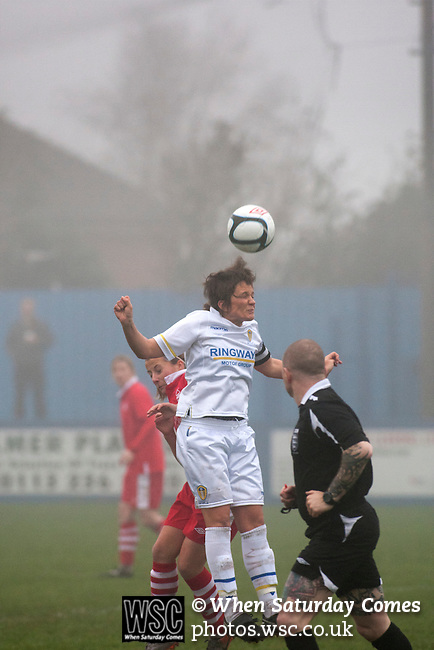 Leeds United Ladies 1 Nottingham Forest Ladies 1, 13/11/2011. Throstle Nest, FA Premier League National Division. Leeds United Ladies FC midfielder Clare Sykes heading the ball, during the first half against Nottingham Forest Ladies FC in an FA Premier League National Division fixture at the Throstle Nest, Farsley, West Yorkshire. The match ended in a one-all draw, watched by fewer than 50 spectators at the club's regular home ground. Formed in 1989, Leeds United Ladies has been one of England's top women's sides for most of the last ten years and played in the top winter league for ladies' teams. Photo by Colin McPherson.