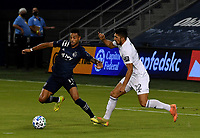 KANSAS CITY, KS - OCTOBER 07: #11 Khiry Shelton of Sporting Kansas City shields the ball away from #22 Mauricio Pineda of Chicago Fire FC during a game between Chicago Fire and Sporting Kansas City at Children's Mercy Park on October 07, 2020 in Kansas City, Kansas.