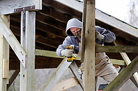 Chris Allen, with the city of Fayetteville Parks and Recreation Department, secures a post Monday, January 11, 2021, to support a roof over bleacher seats at the Lake Fayetteville softball fields. The old posts are being replaced with posts placed on concrete foundations. Monday through Saturday. Check out nwaonline.com/2101012Daily/ and nwadg.com/photos for a photo gallery.<br /> (NWA Democrat-Gazette/David Gottschalk)