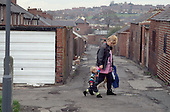 Mother and child in Grimthorpe, South Yorkshire, shortly after the announcement of the planned closure of Grimethorpe colliery, the village's main source of employment.