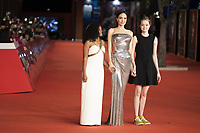 """US actress Angelina Jolie (C) poses with her daughters Zahara Jolie-Pitt (L) and Shiloh Jolie-Pitt (R) on the red carpet for the screening of the film """"Eternals at the 16th edition of the Rome Film Fest in Rome, on October 24, 2021.<br /> UPDATE IMAGES PRESS"""