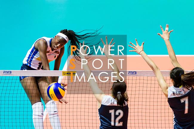 Paola Ogechi Egonu of Italy (L) attacks during the FIVB Volleyball Nations League Hong Kong match between China and Italy on May 31, 2018 in Hong Kong, Hong Kong. Photo by Marcio Rodrigo Machado / Power Sport Images
