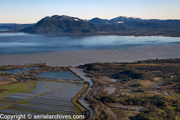 aerial photograph of rice fields and levees at Rodman Slough, North Lakeport, Lake County, California toward Mount Konocti