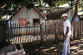 Xapuri, Acre State, Brazil. Rubber tapper outside the Chico Mendes Foundation office.