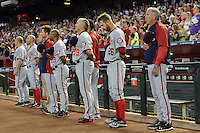 Washington Nationals manager Davey Johnson (5) lines up for the national anthem with Jeff Kobernus (26), Rick Schu (39), Tony Beasley (13) before Johnson's last game, announcing his retirement, against the Arizona Diamondbacks at Chase Field on September 29, 2013 in Phoenix, Arizona.  Arizona defeated Washington 3-2.  (Mike Janes/Four Seam Images)