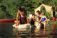 Family and pets camping near lake. Camping, swimming, canoeing, tent, recreation, vacation, leisure, family activities, togetherness. dogs. Mount Shasta California USA Lake Siskiyou.