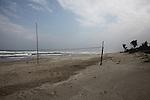 A volleyball net sits on the beach near Hoa's Place guesthouse south of Da Nang, Vietnam. Dec. 25, 2012.