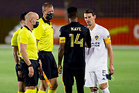CARSON, CA - SEPTEMBER 06: Mark-Anthony Kaye #14 of the LAFC and Daniel Steres #5 of the Los Angeles Galaxy meet with the referee's during a game between Los Angeles FC and Los Angeles Galaxy at Dignity Health Sports Park on September 06, 2020 in Carson, California.