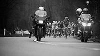 Liège-Bastogne-Liège 2013..Alberto Contador (ESP) attacking on the Côte de Colonster, sprinting away towards the tv- & photo-moto's ahead.
