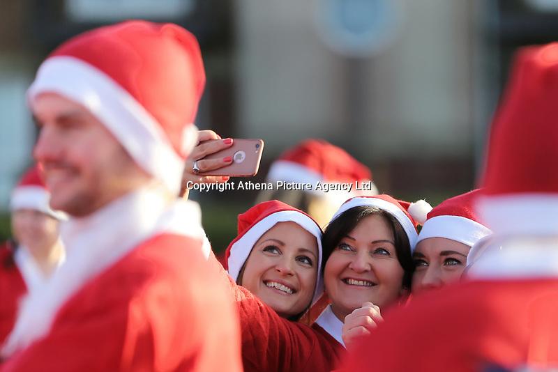 Pictured: Runners in Santa Claus fancy dress take a selfie in this year's run in Aberavon, Wales, UK. Saturday 16 December 2017<br /> Re: 500 people have taken part in Run4All Santa 5km Run on Aberavon Promenade near Port Talbot, Wales, UK.