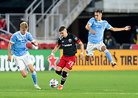 WASHINGTON, DC - APRIL 17: Joseph Mora #28 of D.C. United passes the ball during a game between New York City FC and D.C. United at Audi Field on April 17, 2021 in Washington, DC.