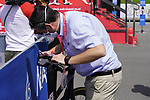 UCI Commissaire scans the bikes for any hidden motors at sign on before the start of Stage 6 of the 2021 UAE Tour running 165km from Deira Island to Palm Jumeirah, Dubai, UAE. 26th February 2021.  <br /> Picture: Eoin Clarke   Cyclefile<br /> <br /> All photos usage must carry mandatory copyright credit (© Cyclefile   Eoin Clarke)