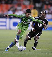 Seattle Sounder FC. forward Fredy Montero (17) shields the ball against DC United defender Julius James (2).  The Seattle Sounders FC defeated DC United 2-1at RFK Stadium, Saturday September 12 , 2009.