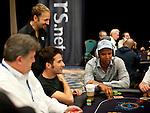 Team Pokerstars Pro Daniel Negreanu talks to fellow pro Phil Ivey.