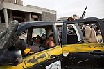 Young anti-Gaddafi fighters slept in their truck on the front line in the Seven Hundred neighborhood of Sirte, Libya, Oct. 7, 2011. Revolutionaries pressed in to Col. Muammar Gaddafi's hometown, encountering fierce resistance snipers, rocket-propelled grenades, and mortars.