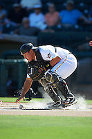Surprise Saguaros Jin-De Jhang (77), of the Pittsburgh Pirates organization, picks up the ball after a blocked pitch in the dirt during a game against the Glendale Desert Dogs on October 22, 2016 at Surprise Stadium in Surprise, Arizona.  Surprise defeated Glendale 10-8.  (Mike Janes/Four Seam Images)