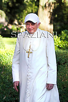 Pope Benedict XVI wearing a white cap as he strolls in the pontiffs' summer residence in Castel Gandolfo where he is spending his vacations, in the hills overlooking Rome on July 22, 2010. SPAZIANI/ POOL/ OSSERVATORE ROMANO